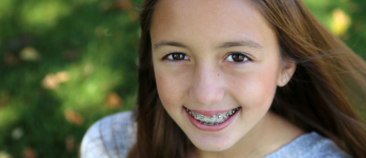 Teen gril smiling with braces