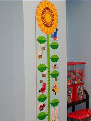 Patient wall chart at North Shore Pediatric Dental and Orthodontics